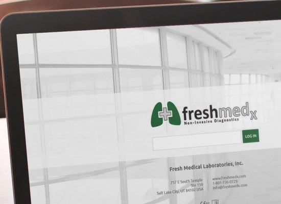 Zoomed in picture of Fresh Medical Laboratories website on a laptop